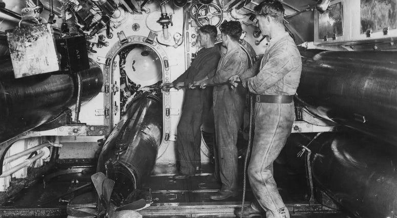 British submariners load a torpedo