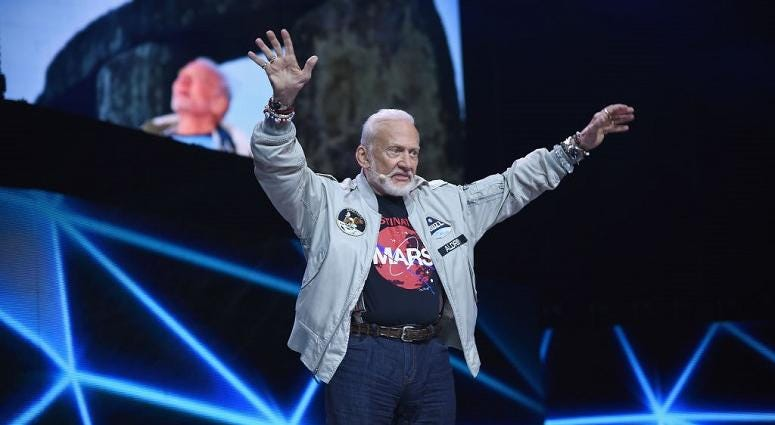 "Legendary astronaut Buzz Aldrin punches out a conspiracy theorist who called him a ""coward and a liar."""