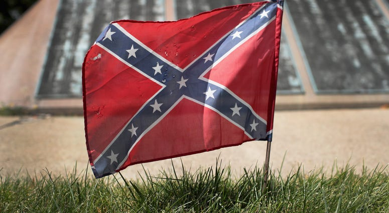 A Confederate Navy jack flag sits at the base of Confederate Mound, a memorial to more than 4,000 Confederate prisoners of war who died in captivity at Camp Douglas and are buried around the monument,