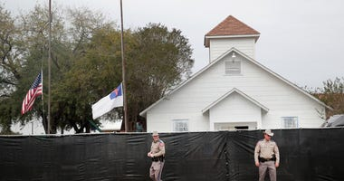 Police keep watch outside of the First Baptist Church of Sutherland Springs