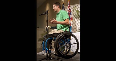 Retired Senior Airman Brian Kolfage, keynote presenter and wounded warrior, addresses the audience during the 52nd Annual Navy League Sea Service Awards Luncheon at the Ala Moana Hotel in 2012.