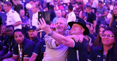U.S. Army veteran Tom Bomke takes a selfie with Jon Stewart at the DoD Warrior Games opening ceremony, June 22, 2019, at Amalie Arena in Tampa during the Department of Defense Warrior Games.