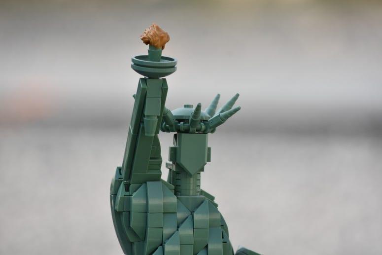 Sgt. 1st Class Mark W. Keevan makes Lego models