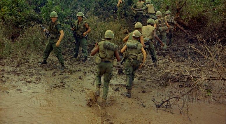Marines entering the jungle circa 1969