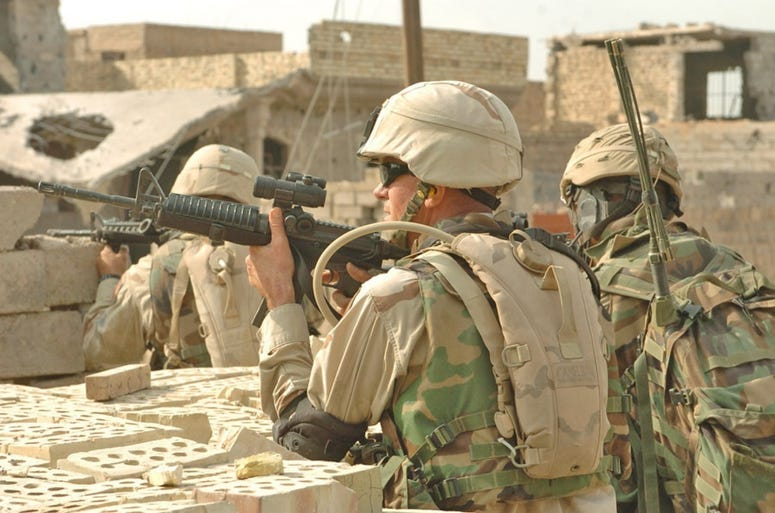 3rd Brigade Combat Team CSM John D. Fourhman, fires at insurgents, during Operation Al-Fajr in Fallujah November 2004