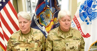 Lt. Col. Lynn Currier, an information management branch manager, and Master Sgt. Lisa Currier, a senior logistics officer, assigned to the New York National Guard Headquarters here, prepare for Lynn's retirement from the New York National Guard during a c
