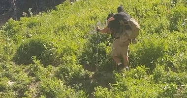 Marine carries fellow veteran up Mt. Timpanogos hike in Utah