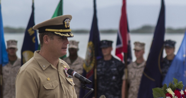 In this June 3, 2014, image provided by the U.S. Navy, Navy Capt. John R. Nettleton, then-commanding officer of Naval Station Guantanamo Bay, Cuba, speaks during a Battle of Midway commemoration ceremony.