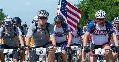 President George W. Bush participates in the Bush Center Warrior 100K Ride