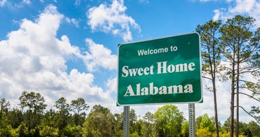 Welcome to Sweet Home Alabama Road Sign along Interstate 10 in Robertsdale, Alabama USA, near the State Border with Florida.