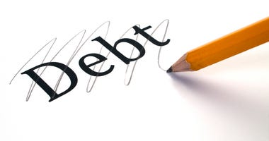 The word debt marked through, yellow pencil