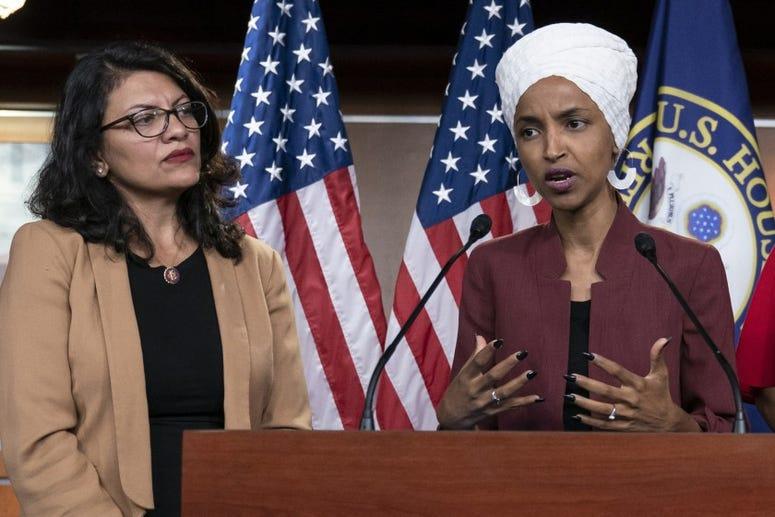 Rep Ilhan Omar speaks at a press conference with Rep Rashida Tlaib