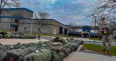 The duffel bags of Soldiers are lined at the road as they prepare for a middle east deployment.