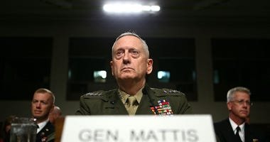 Marine Corps Gen. James Mattis listens during his confirmation hearing July 27, 2010 on Capitol Hill in Washington, DC.