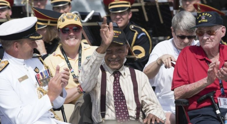 World War II veteran Anthony H. Grant is recognized during a ceremony at the National World War II Memorial to commemorate the 75th anniversary of D-Day and Operation Overlord, Washington, D.C., June 6, 2019.