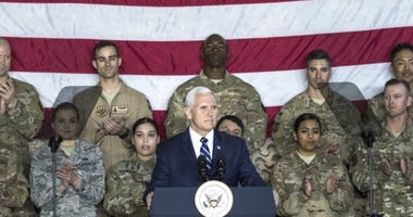 U.S. Vice President Mike Pence speaks to a crowd of deployed service members assigned to the 332d Air Expeditionary Wing January 21, 2018 at an undisclosed location in Southwest Asia. Pence's visit came as part of an extended trip across the Middle East.