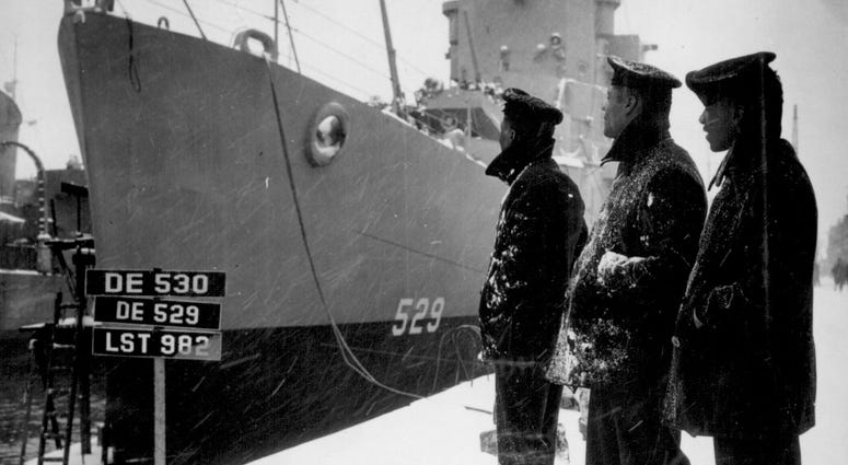 Negro sailors of the U.S.S. Mason (DE 529) commissioned at Boston Navy Yard proudly look over their ship which is the first to have a predominately Negro crew