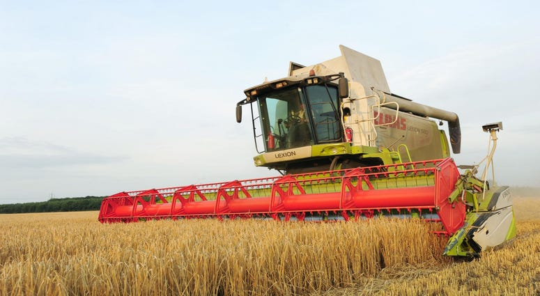 File photo dated 20/08/13 of a combine harvester at work in a field.