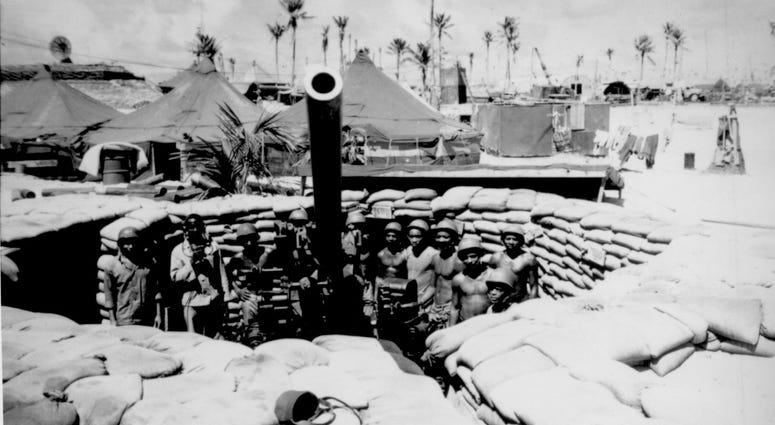 Surrounded by a veteran crew of Marines who have spent 15 months in the Southwest and Central Pacific, this gun, named the 'Lena Horne' by its crew, points majestically skyward.