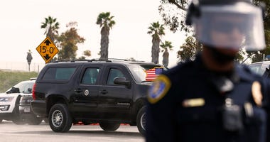U.S. President Donald Trump leaves the U.S.-Mexico border after inspecting border wall prototypes in San Diego, the United States, on March 13, 2018.