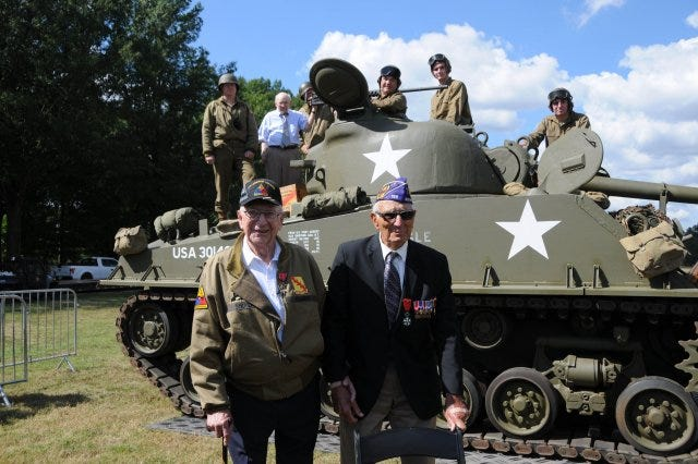 Veterans Clarence Smoyer and Joe Caserta stand near a Pershing tank