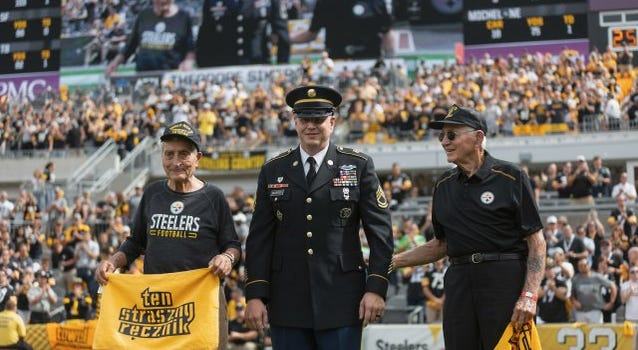"""Theodore """"Ted"""" Sikora, left, and Edward """"Ed"""" Sikora, right. are honored by the Pittsburgh Steelers"""