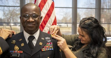 Maj. Tatchie Manso has the rank of Major pinned on him