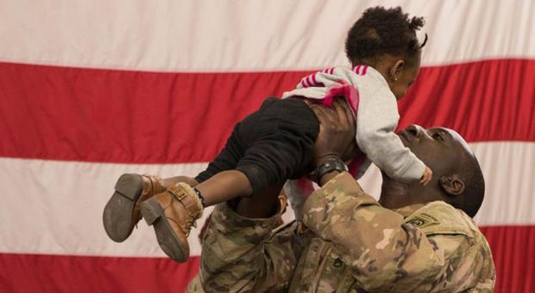 A soldier reunites with his daughter at Fort Bragg, N.C. after returning from the Middle East.