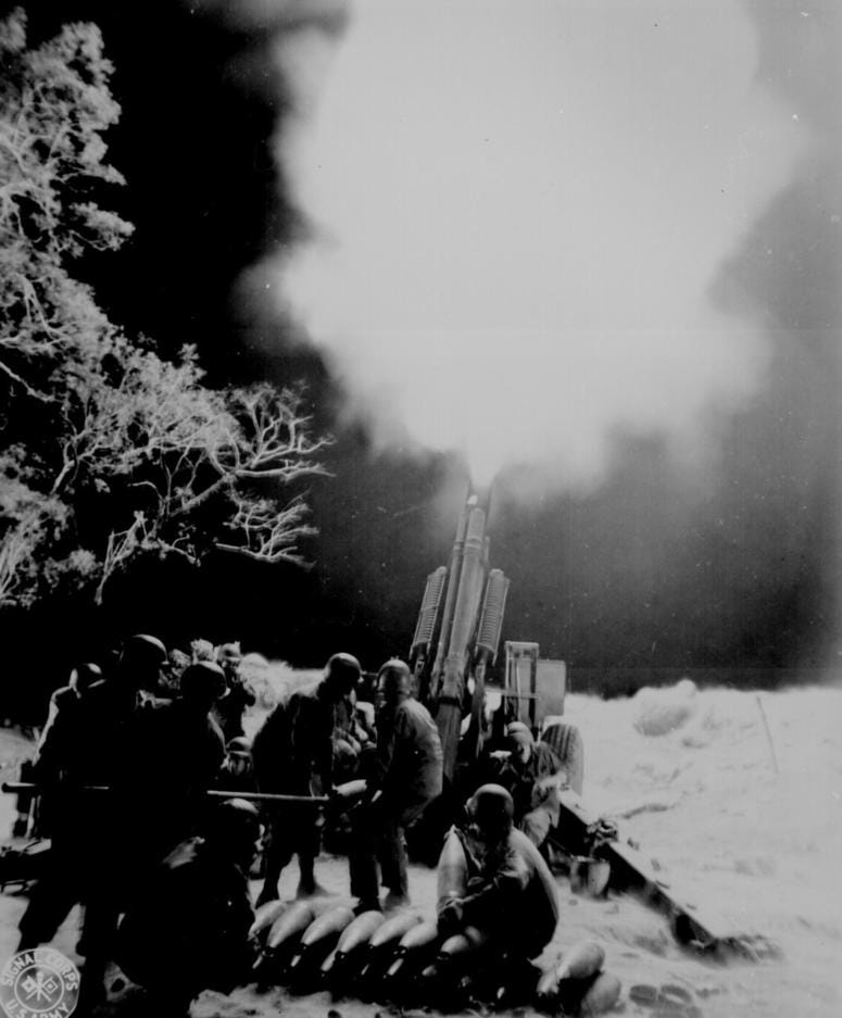 Soldiers of C Battery, 90th Field Artillery, lay down a barrage on Japanese artillery positions in Balete Pass in the Philippines, April 19, 1945.