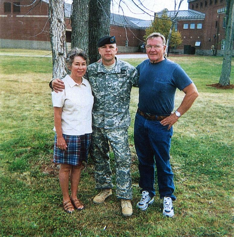 Army Sgt. Travis Atkins with his parents, Jack and Elaine, during a visit to see him at Fort Drum, N.Y., in 2006.