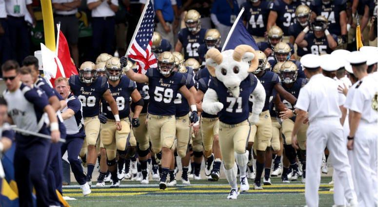 Navy football team takes the field