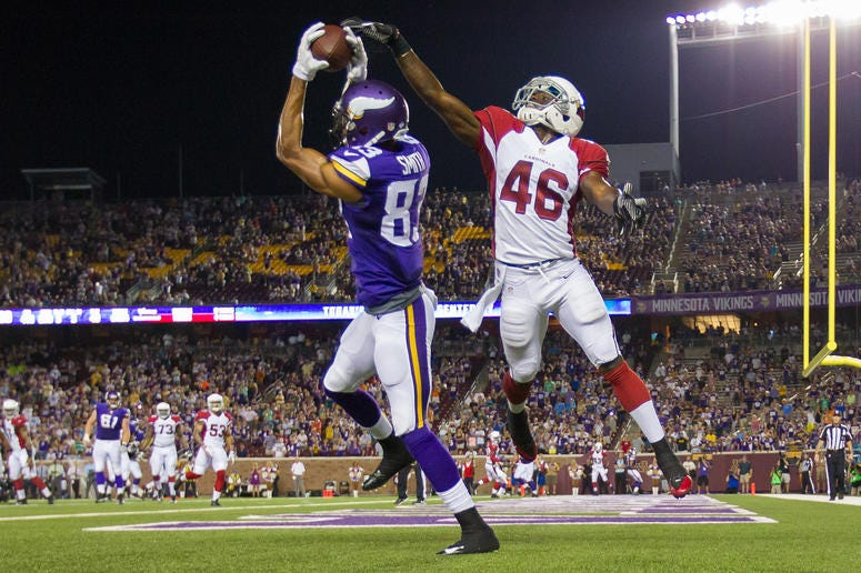Minneapolis, MN, USA; Minnesota Vikings wide receiver Rodney Smith (83) catches a touchdown in front of Arizona Cardinals cornerback Jimmy Legree (46) the fourth quarter at TCF Bank Stadium