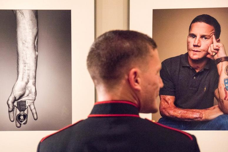 U.S. Marine Cpl. Kyle Carpenter observes his portrait at the National Portrait Gallery in Washington, D.C., Nov. 15, 2015. Carpenter is the youngest living Medal of Honor recipient.