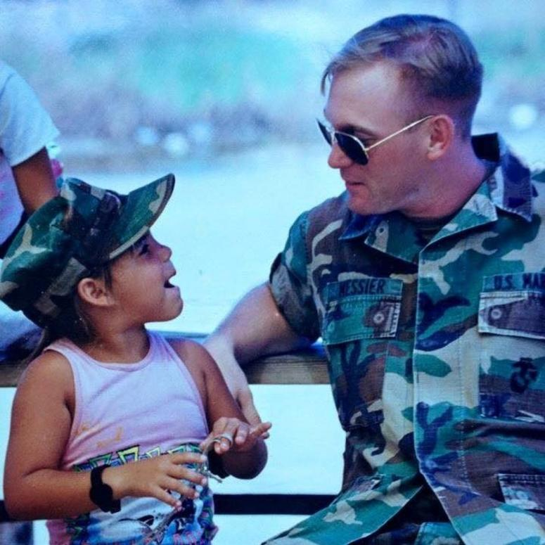 Jake Messier with a Cuban refugee in Guantanamo Bay in 1995.