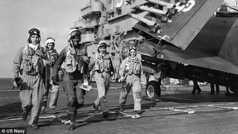 Brown, pictured with his crew on board USS Leyte