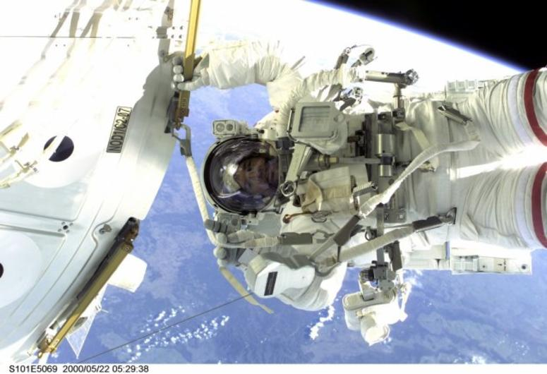 Jeff Williams takes part in a spacewalk during STS-101