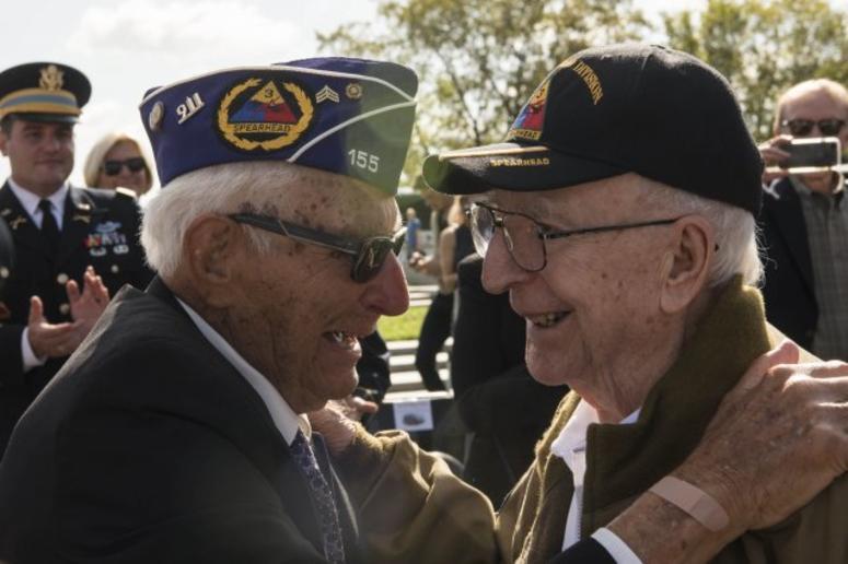 World War II veterans Joe Caserta and Clarence Smoyer embrace