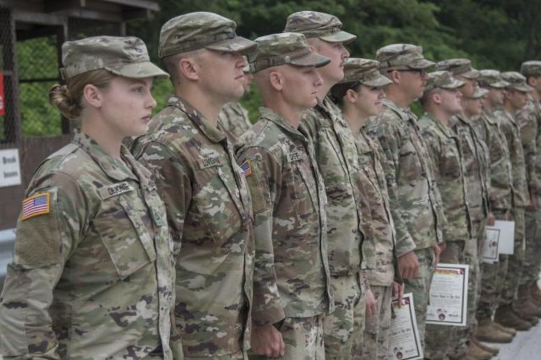 Nebraska National Guard Soldiers with the 1-134th Cavalry Squadron receive certificates and silver spurs after successful completion of a spur ride during annual training in the Republic of Korea.