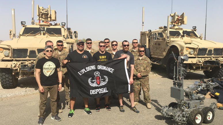 Titan FC COO Lex McMahon and Titan FC Fighters visit with EOD troops on a 2016 visit to Kuwait