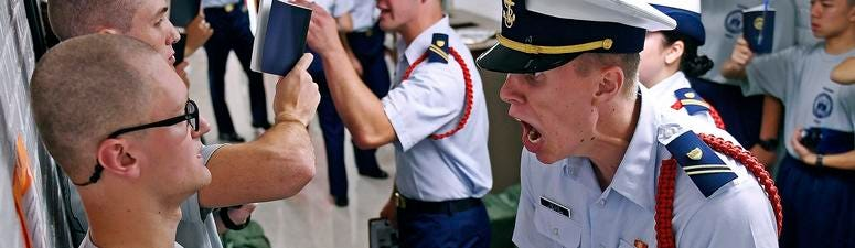 Whisky 2 company Cadre Jacob Denns, right, shouts instructions to swab Nicolas Fisher, left, of Pelham, N.H., during haircut and mailbox issue on the first day of a seven-week indoctrination to military academy life for the Class of 2023.
