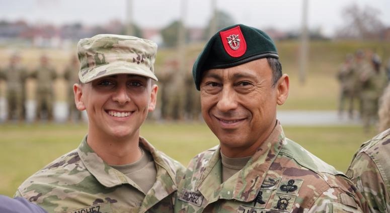 Command Sgt. Maj. Terry M. Sanchez (right), command sergeant major of the 7th Special Forces Group (Airborne), and Pvt. Diego Sanchez (left) pause for a photo during the graduation ceremony at the U.S. Army Airborne School