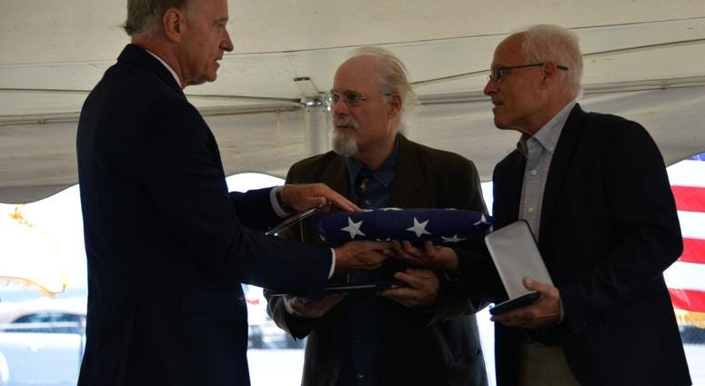 Massachusetts U.S. Representative Bill Keating presented Stephen and Bradley Finch with an American flag