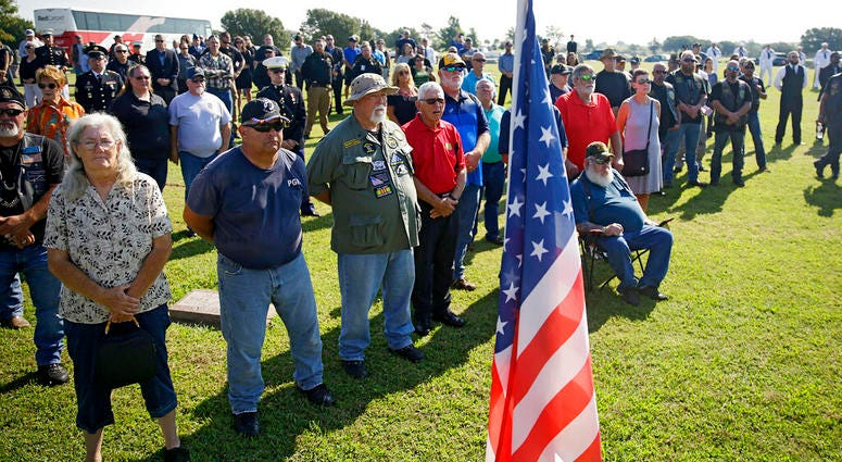 Mourners attend a funeral service for World War II veteran Herman White