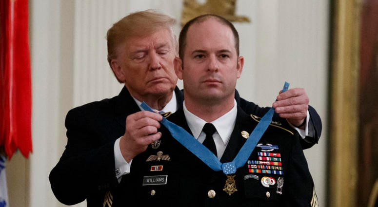 President Donald Trump places the Medal of Honor on Army Master Sgt. Matthew Williams, currently assigned to the 3rd Special Forces Group, during a Medal of Honor Ceremony in the East Room of the White House,