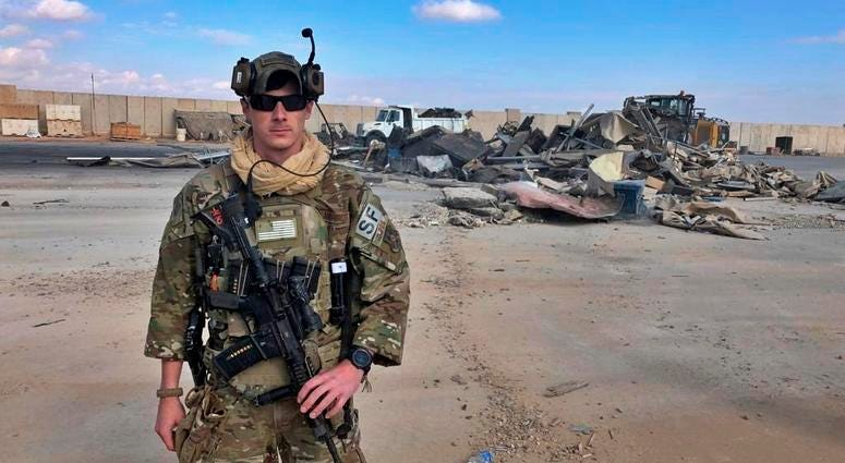 A U.S. soldier stands while bulldozers clear rubble and debris at Ain al-Asad air base in Anbar, Iraq, Monday, Jan. 13, 2020. Ain al-Asad air base was struck by a barrage of Iranian missiles on Wednesday, in retaliation for the U.S. drone strike that kill