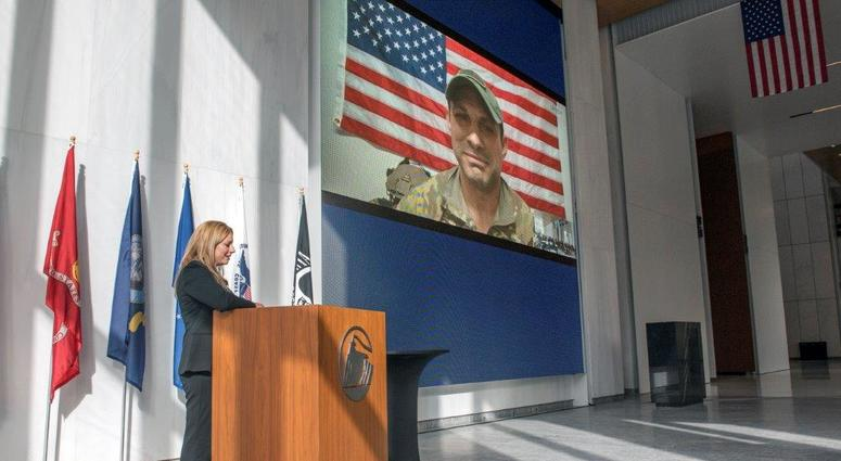 Nicole speaking to her husband Jared via Skype, during Prudential's 2017 Veterans Day event in Newark, NJ.