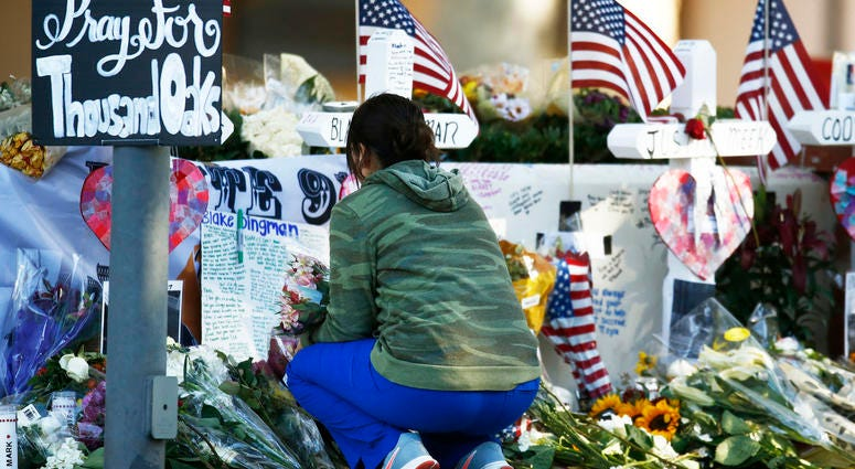 Nov. 12, 2018; Thousand Oaks, CA, USA; Visitors continue to bring flowers and leave personal messages at the mass shooting memorial