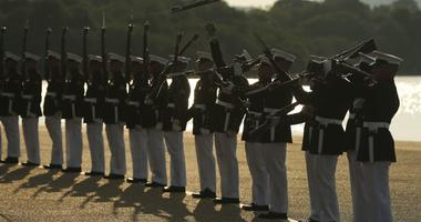 """Marines with the U.S. Marine Corps Silent Drill Platoon execute their """"long line"""" sequence."""