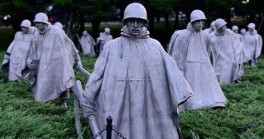 Statues of American Soldiers maneuvering at the Korean War Veterans Memorial in Washington D.C.