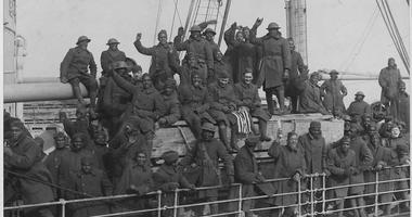"War Department. New York's 369th Infantry (formerly the 15th Infantry) of African American troops arrive back home at Hoboken, New Jersey. According to the original caption, ""they are the only regiment which never had one of their men captured and never l"